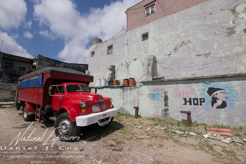 A newly painted red Chevy dump truck on the streets of Ceinfuegos, Cuba.