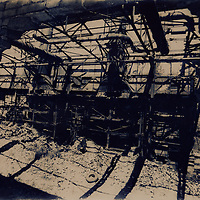 This scene was taken in Kladno, city near by Prague, in the Czech republic. Large unused industrial area of former ironworks and foundries is decaying. Image was created by using an alternative photographic process called cyanotype.