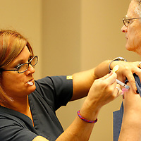 Thomas Wells | BUY at PHOTOS.DJOURNAL.COM<br /> Carrie Crump gives City of Tupelo employee Pat Faulkner a flu shot on Wednesday at City Hall.