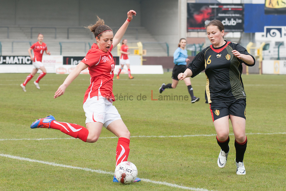 21120413 - HARELBEKE, BELGIUM : Switzerland's  Sabrina Ribeaud (11)  and Belgium's  Valentine Hannecart (6)  fight for the ball during the Second qualifying round of U17 Women Championship between Switzerland and Belgium on Friday April 13th, 2012 in Harelbeke, Belgium.