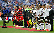 The players of Derby County and Queens Park Rangers line up prior to kick off during the Sky Bet Championship Play Off final at Wembley Stadium, London<br /> Picture by Andrew Tobin/Focus Images Ltd +44 7710 761829<br /> 24/05/2014
