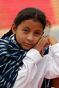 A GIRL FROM LAMUD POSE FOR THE CAMERA.
