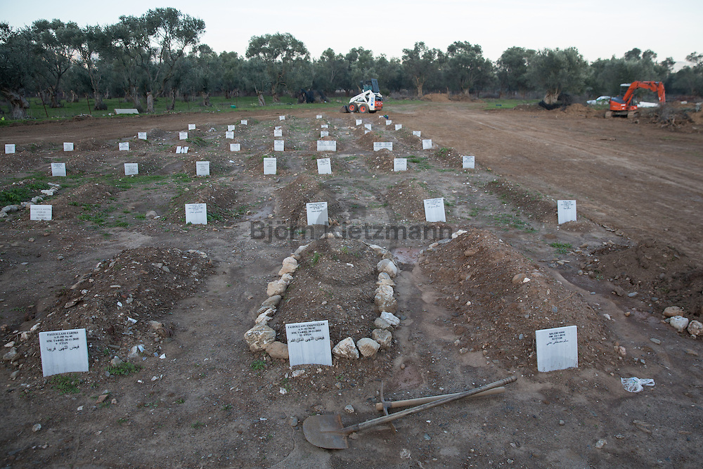 Kara Trikos, Lesbos, Greece - 28.02.2015  <br /> <br /> Graveyard for refugees on the Greek island Lesbos. After the paupers' cemetery of the island was full, a cemetery specially for refugees was created near the village Kara Tritos. In Numerous graves are people whose names are not known. With building machines also the area for graves is being expanded. <br /> <br /> Friedhof f&uuml;r Fluechtlinge auf der griechischen Insel Lesbos. Nachdem der Armenfriedhof der Insel voll war, wurde nahe des Dorfs Kara Tritos ein Friedhof speziell f&uuml;r Fluechtlinge angelegt. In vielen Graebern liegen unbekannte Menschen. Mit Baumaschinen findet zudem gerade ein Ausbau der Grabflaechen.