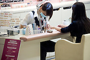 a woman getting a pedicure in a Tokyo cosmetic shop