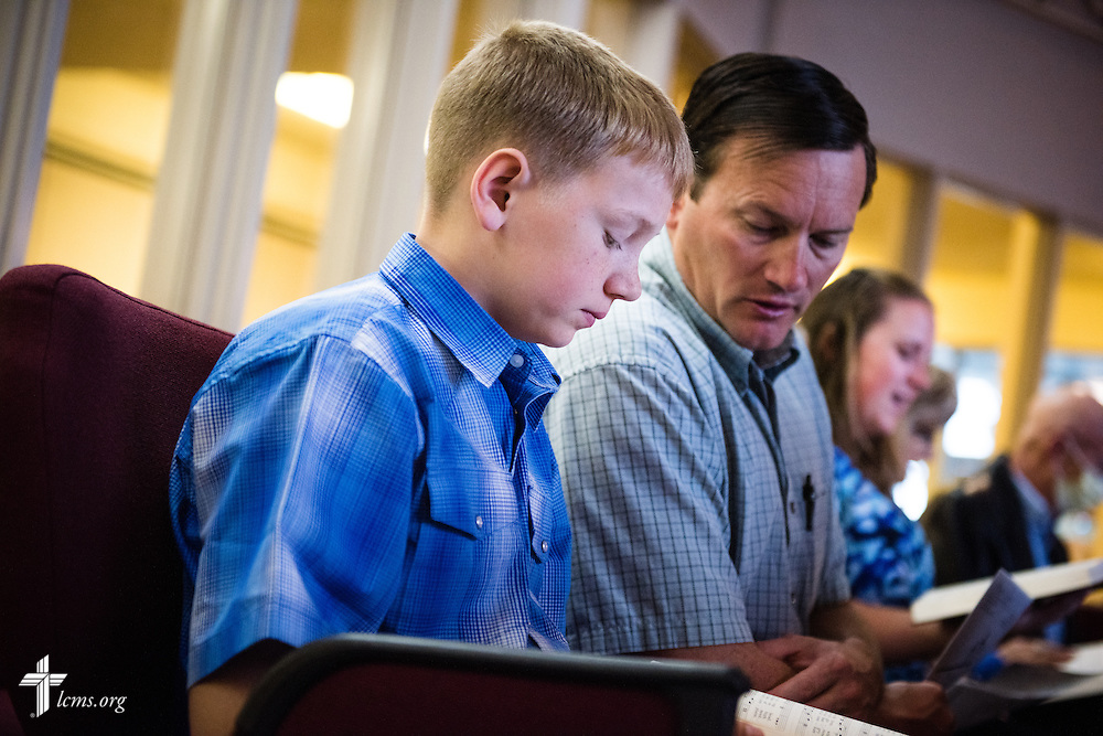 A father and son worship Sunday, April 12, 2015, at Mount Calvary Lutheran Church in Holdrege, Neb. LCMS Communications/Erik M. Lunsford