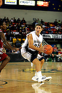 25 November 2005:  Monmouth senior guard looks for a bounce pass in the South Carolina 62-56 victory over the Blue and White at the Great Alaska Shootout in Anchorage, Alaska
