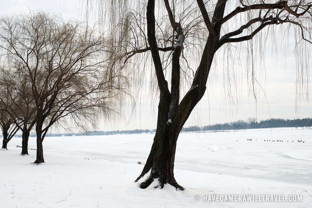 The Potomac is frozen over and covered in snow after a winter snow storm in Washington DC.