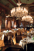 The Banquet Hall at the Falaknuma Palace, Hyderabad. Falaknuma Palace has the largest collection of Venetian and Belgian chandeliers by Osler in India.