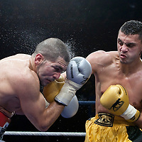 19 November 2009: Fight between Djamel Selini (grey trunks) and Tarik Khaidouri (yellow trunks) during the Grand Tournoi boxing semi finals event at Cirque d'Hiver in Paris, France..