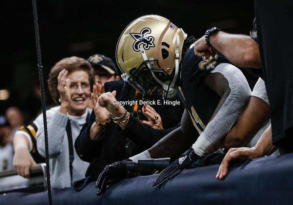 Dec 17, 2017; New Orleans, LA, USA; New Orleans Saints running back Alvin Kamara (41) celebrates with fans in the stands after a touchdown against the New York Jets during the second quarter at the Mercedes-Benz Superdome. Mandatory Credit: Derick E. Hingle-USA TODAY Sports