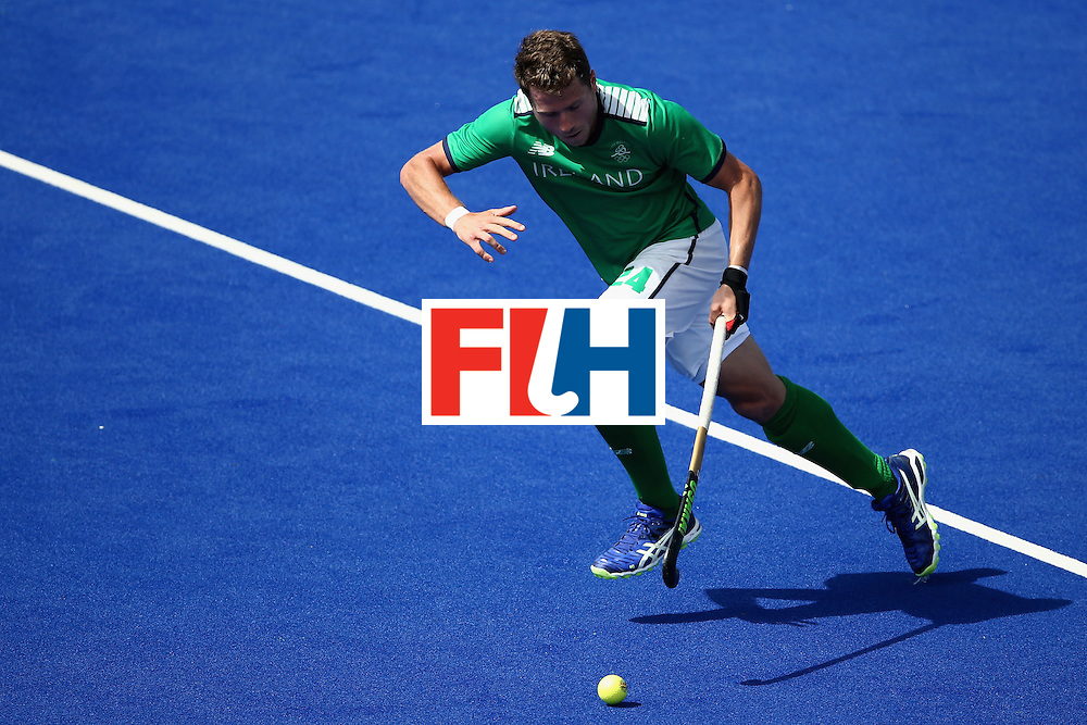 RIO DE JANEIRO, BRAZIL - AUGUST 11:  Kyle Good #24 of Ireland runs upfield against Canada during a Men's Preliminary Pool B match on Day 6 of the Rio 2016 Olympics at the Olympic Hockey Centre on August 11, 2016 in Rio de Janeiro, Brazil.  (Photo by Sean M. Haffey/Getty Images)