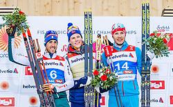 21.02.2019, Langlauf Arena, Seefeld, AUT, FIS Weltmeisterschaften Ski Nordisch, Seefeld 2019, Langlauf, Herren, Sprint, Flower Zeremonie, im Bild v.l. Silbermedaillengewinner Federico Pellegrino (ITA), Weltmeister und Goldmedaillengewinner Johannes Hoesflot Klaebo (NOR), Bronzemedaillengewinner Gleb Retivykh (RUS) // f.l. Silver medalist Federico Pellegrino of Italy World champion and Gold medalist Johannes Hoesflot Klaebo of Norway Bronce medalist Gleb Retivykh of Russian Federation during the Flowers ceremony for the men's Sprint competition of the FIS Nordic Ski World Championships 2019. Langlauf Arena in Seefeld, Austria on 2019/02/21. EXPA Pictures © 2019, PhotoCredit: EXPA/ Stefan Adelsberger