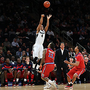 Josh Fortune, Providence, shoots for three during the Providence Vs St. John's Red Storm basketball game during the Big East Conference Tournament at Madison Square Garden, New York, USA. 12th March 2014. Photo Tim Clayton