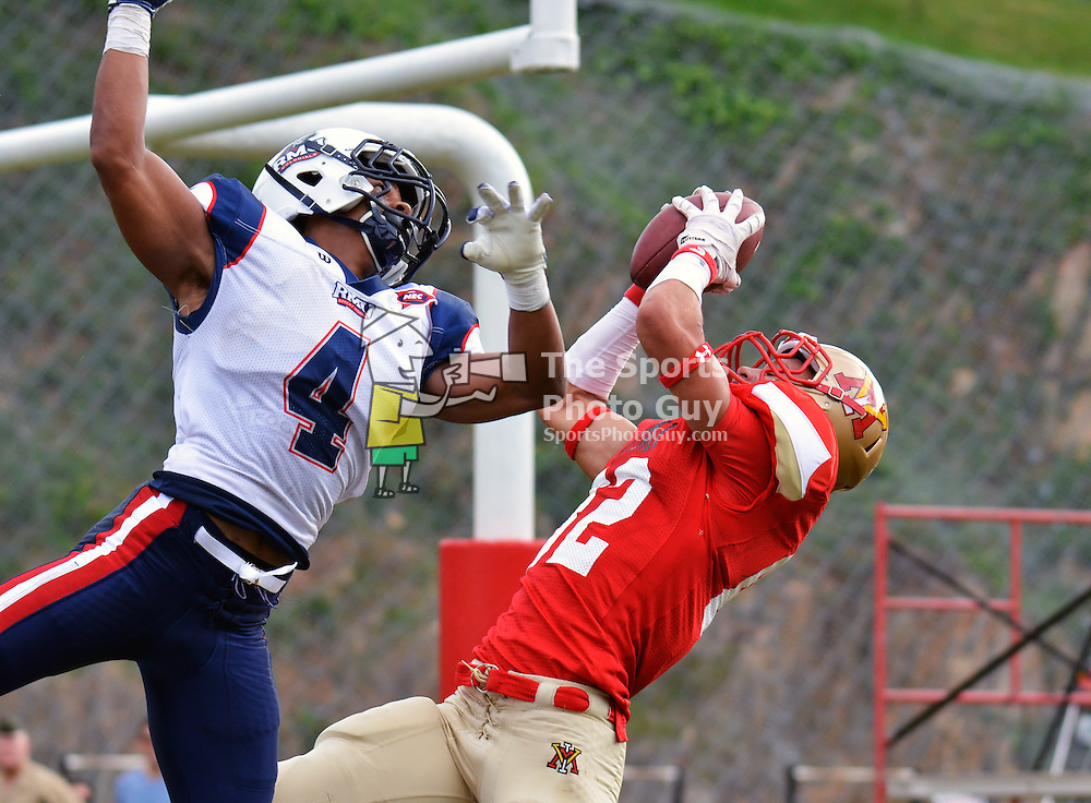 """NCAA FCS: Robert Morris defeats VMI, 37-31, in double-overtime thriller - VMI wide receiver Matthew Nicholson (#82) hauls in a 39-yard pass as Robert Morris safety Marcelis Branch defends.  The """"Hail Mary"""" bomb tied the game at 31 with one second remaining in regulation, though Robert Morris would go on to win 37-31 after two overtime periods."""