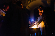 DENVER, CO - APRIL 19: Seminarian Peter Wojda lights the fire during the Easter Vigil Mass at the Cathedral Basilica of the Immaculate Conception on April 19, 2014, in Denver, Colorado. (Photo by Daniel Petty/Denver Catholic Register)