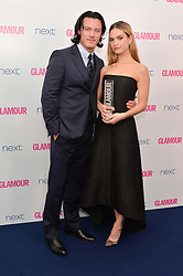 LUKE EVANS and LILY JAMES at the Glamour Women of The Year Awards in Association with Next held in Berkeley Square Gardens, Berkeley Square, London on 3rd June 2014.