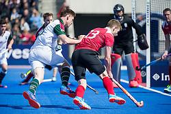 Holcombe's Sam Ward drives into the circle. Holcombe v Surbiton - Semi-Final - Men's Hockey League Finals, Lee Valley Hockey & Tennis Centre, London, UK on 22 April 2017. Photo: Simon Parker