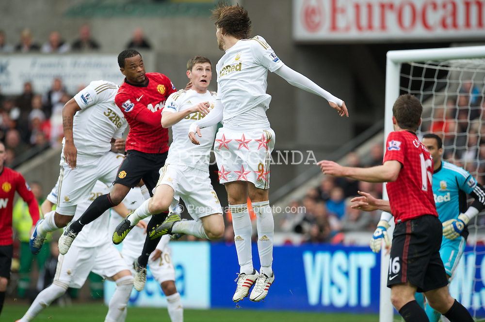 SWANSEA, WALES - Sunday, December 23, 2012: Manchester United's Patrice Evra scores the first goal against Swansea City during the Premiership match at the Liberty Stadium. (Pic by David Rawcliffe/Propaganda)