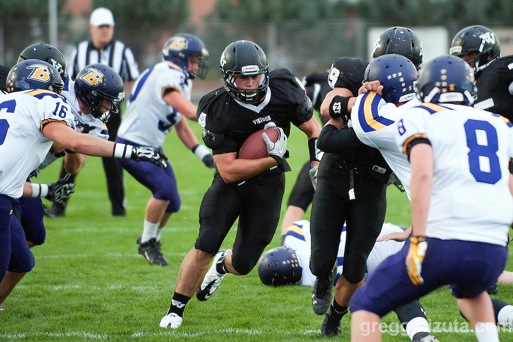 Vale's offensive line opens a big hole for Andrew Weber during the Vale - Baker football game, September 26, 2014 at Frank Hawley Stadium, Vale High School, Vale, Oregon. Vale won 58-28 to improve its season record to 4-0. Weber had 61 receiving yards, 68 rushing yards and one touchdown.