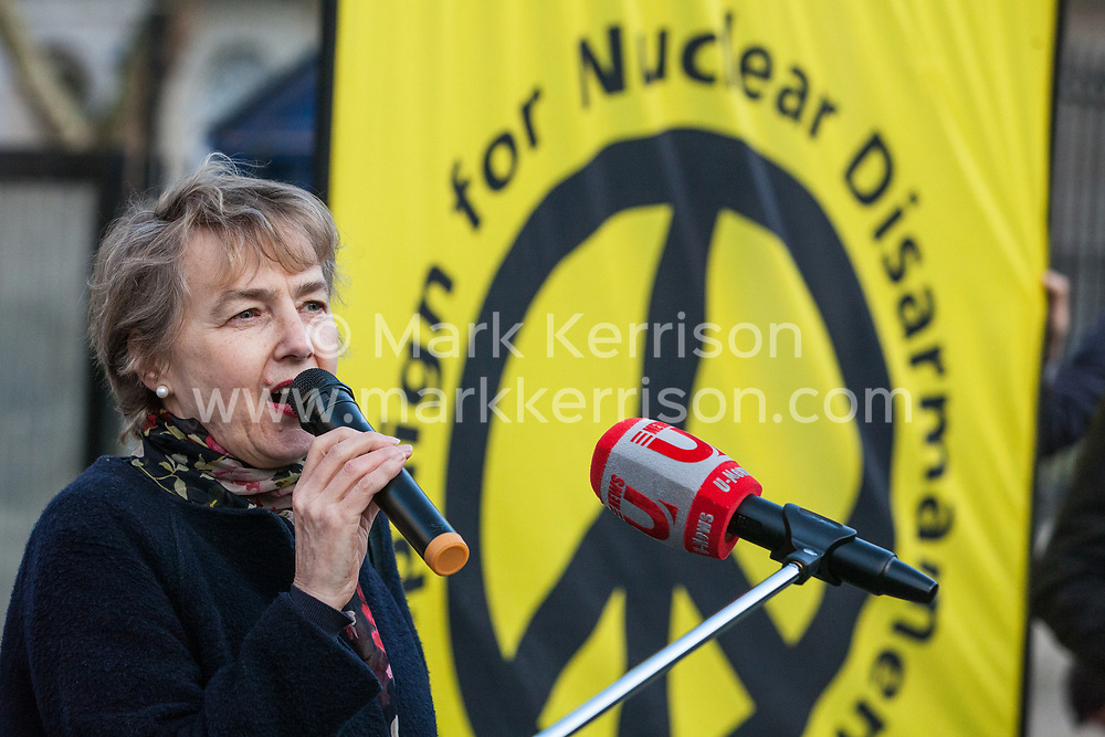 London, UK. 26th March, 2019. Kate Hudson, General Secretary of the Campaign for Nuclear Disarmament (CND) addresses human rights campaigners from several different groups including Stop The War Coalition and Campaign Against the Arms Trade protesting opposite Downing Street against British arms sales to Saudi Arabia used to wage a 4-year war in Yemen. According to charity Save The Children, an estimated 85,000 children under the age of five may have died from acute malnutrition since the war began in 2015 and 14 million Yemenis are believed to face the risk of famine; according to the United Nations, millions of citizens have been displaced, over 56,000 Yemenis have been killed and the country is facing the 'world's worst humanitarian crisis'.