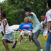 WASHINGTON, DC -JUNE4:  Council member Yvette Alexander (D-Ward 7) watches neighborhood youth dance at River Terrace, June 4, 2016, following an anti-violence march in Washington, DC. Alexander is in the fight for her political life as her one time mentor and former Mayor Vincent Gray mounts a comeback, assailing her for poor constituent services, failure to respond to rising crime in the ward and bungling oversight of St. Elizabeths hospital and DC trust. (Photo by Evelyn Hockstein/For The Washington Post)