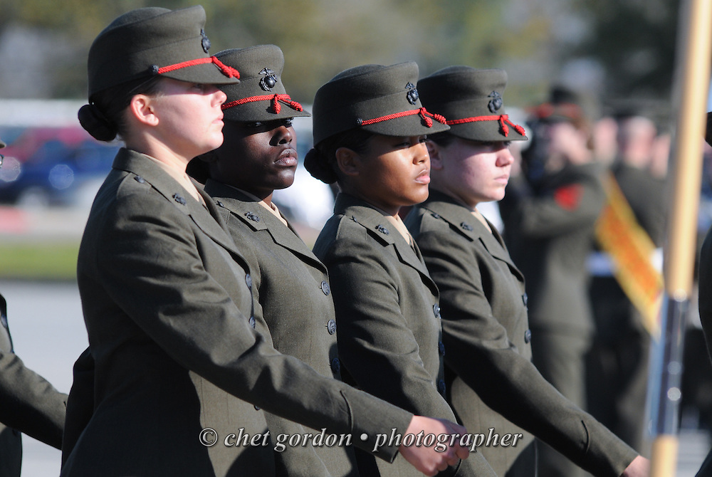 Graduating female Marine Corps recruits march in the pass and review formation during their graduation ceremony at the Marine Corps Recruit Depot (MCRD) in Parris Island, SC on Friday, March 15, 2013.