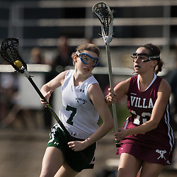 Nerinx Hall's Perry Lodes (7) drove against Villa Duchesne's Grace Walsh (13) in the first half of a game between Nerinx Hall High School and Villa Duchesne at Nerinx Hall in Webster Groves April 5, 2016. Villa Duchesne won 9-8. Teak Phillips | St. Louis Review