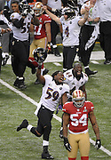 Baltimore Ravens' Dannell Ellerbe (59) and Vonta Leach (44) celebrate after winning Super Bowl XLVII while San Francisco 49ers linebacker Larry Grant (54) walks off the field at the Mercedes-Benz Superdome on February 3, 2013 in New Orleans.  UPI/David Tulis