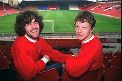 "LIVERPOOL, ENGLAND - 1996: John Power (R) and Peter ""Cammy"" Cammell of band Cast at Anfield, home of Liverpool FC. (Pic by David Rawcliffe/Propaganda)"