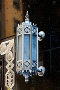 A splendid, Art Deco light fixture stands out against the black marble entrance to a Chase Bank branch on the Lexington Avenue side of the Chrysler Building