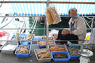 Vendor in Sai Kung, Thursday, March 26, 2015. (TREVOR HAGAN)
