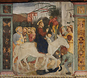 Entry of Christ into Jerusalem, with people laying down their cloaks, detail from a fresco of the crucifixion and scenes from the life of Christ, 1513-15, by an unknown Renaissance Lombard artist of the Scotto school, on the partition wall of the Church of Santa Maria delle Grazie, a Franciscan church built 1480-82 and consecrated 1505, in Bellinzona, Ticino, Switzerland. Picture by Manuel Cohen