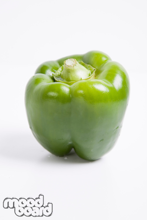 Close-up of green bell pepper over white background
