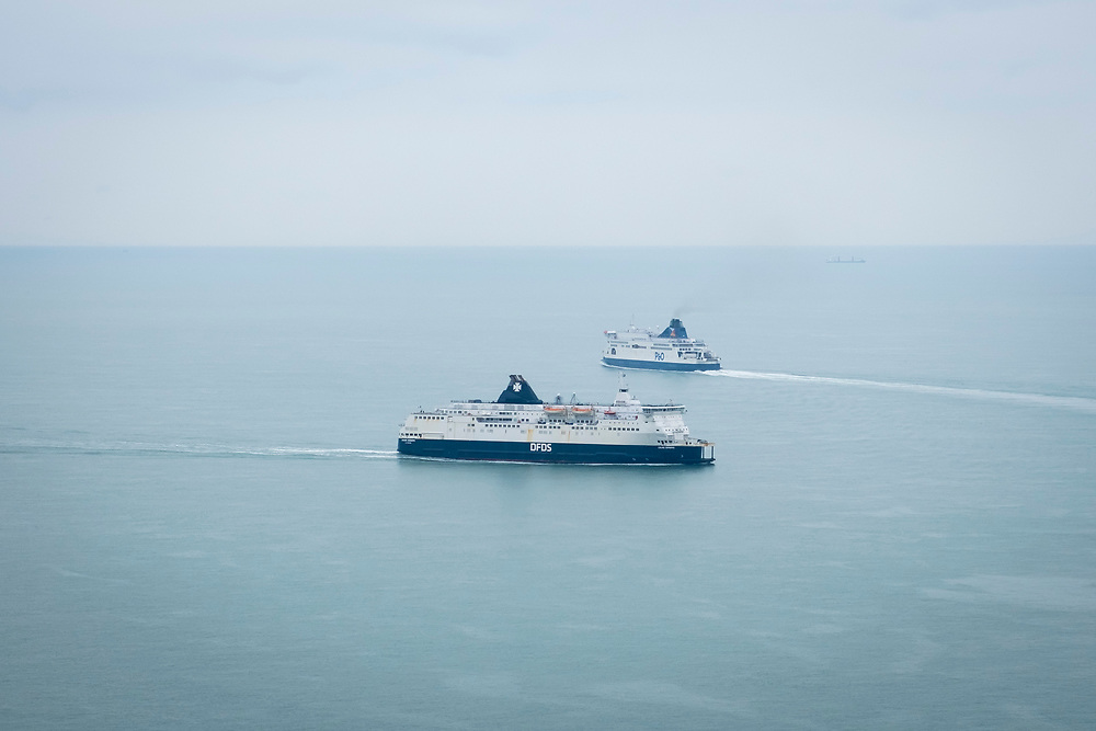 Cross channel ferries P&O and DFDS seaways pass each other outside the port of Dover, United Kingdom.  They cross the 34 kilometres (21 miles)  distance of the English Channel, one of the busiest shipping lanes in the world as they transport vehicles and cargo between the ports of Dover, England and Calais, France. (photo by Andrew Aitchison / In pictures via Getty Images)