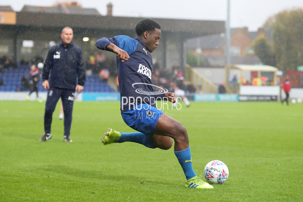AFC Wimbledon attacker Zach Robinson (29) about to shoot at goal whilst warming up and being watched by AFC Wimbledon coach Mark Robinson during the The FA Cup match between AFC Wimbledon and Doncaster Rovers at the Cherry Red Records Stadium, Kingston, England on 9 November 2019.
