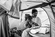 Marcus Emery takes a moment inside his tent at Northgate Avenue and Sycamore Street on Friday, June 9, 2017, in Oakland, Calif.