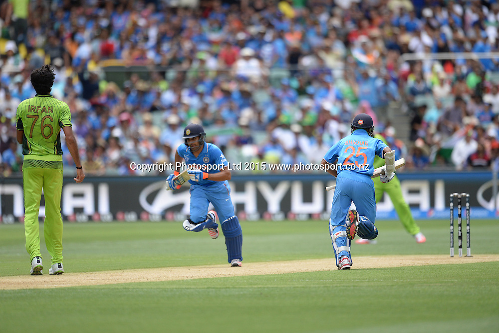 Indian Openers Rohit Sharma and Shikhar Dhawan pinch a single during the ICC Cricket World Cup match between India and Pakistan at Adelaide Oval in Adelaide, Australia. Sunday 15 February 2015. Copyright Photo: Raghavan Venugopal / www.photosport.co.nz