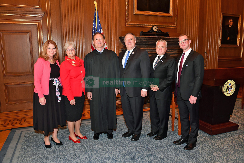 April 26, 2018 - Washington, DC, United States of America - U.S. Secretary of State Mike Pompeo, center, stands for a photo after being sworn in as the 70th Secretary of State in the West Conference Room of the Supreme Court April 26, 2018 in Washington, DC. Standing with Pompeo are: Left to Right: Susan Pompeo, Martha Bomgardner, Supreme Court Justice Samuel Alito, Deputy Secretary of State John Sullivan and Nicholas Pompeo. (Credit Image: © State Department/Planet Pix via ZUMA Wire)