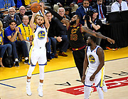 May 31, 2018; Oakland, CA, USA; Golden State Warriors guard Stephen Curry (30) shoots the ball against Cleveland Cavaliers forward LeBron James (23) during the fourth quarter in game one of the 2018 NBA Finals at Oracle Arena.