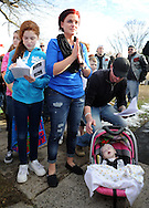 LEVITTOWN, PA -  DECEMBER 28:  Hannah Rose Ginion, whose battle with Krabbe disease inspired a law to update Pennsylvania's newborn screening list, died December 28, 2014. In this file photo, Hannah Rose Ginion sits in her carrier with her mother Vicki Pizzullo C) and father Justin Pizzullo (R) as Santa and visitors sing Christmas carols at the Pizzullo home December 21, 2013 in Levittown, Pennsylvania. Hannah was born with Krabbe, a genetic disorder that affects both the central and peripheral nervous systems. The family is fighting to make newborn screening for the disorder a state law. (Photo by William Thomas Cain/Cain Images)