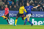 Leicester's Caglar Soyuncu (4) & Watford Ismaila Sarr (23) during the Premier League match between Leicester City and Watford at the King Power Stadium, Leicester, England on 4 December 2019.