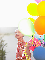 Girl (10-12) with bunch of balloons