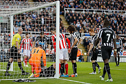 Steven Taylor of Newcastle United is surrounded  after cutting his head collining with the post - Photo mandatory by-line: Rogan Thomson/JMP - 07966 386802 - 21/12/2014 - SPORT - FOOTBALL - Newcastle upon Tyne, England - St James' Park - Newcastle United v Sunderland - Tyne-Wear derby - Barclays Premier League.