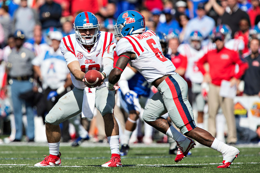 MEMPHIS, TN - OCTOBER 17:  Chad Kelly #10 hands off the ball to Jaylen Walton #6 of the Ole Miss Rebels during a game against the Memphis Tigers at Liberty Bowl Memorial Stadium on October 17, 2015 in Memphis, Tennessee.  The Tigers defeated the Rebels 37-24.  (Photo by Wesley Hitt/Getty Images) *** Local Caption *** Chad Kelly; Jaylen Walton