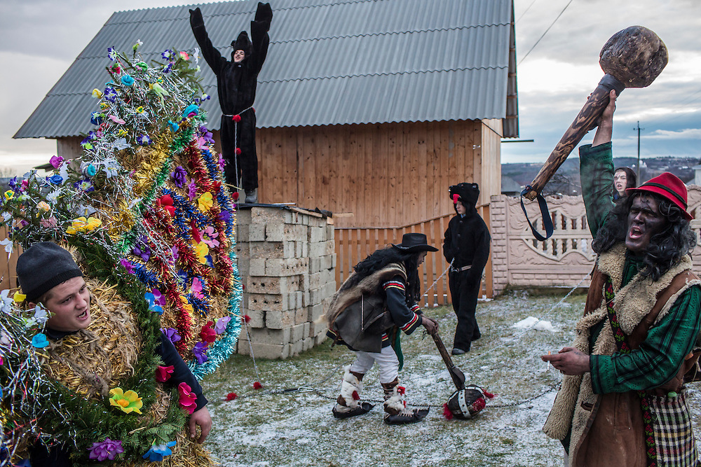 Revelers in the costumes of bears and gypsies celebrate the Malanka Festival on Thursday, January 14, 2016 in Krasnoilsk, Ukraine. The annual celebrations, which consist of costumed villagers going in a group from house to house singing, playing music, and performing skits, began the previous sundown, went all night, and will last until evening.