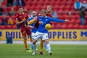 David Wotherspoon (#10) of St Johnstone FC shields the ball from Richard Tait (#2) of Motherwell FC during the Ladbrokes Scottish Premiership match between St Johnstone and Motherwell at McDiarmid Stadium, Perth, Scotland on 11 May 2019.