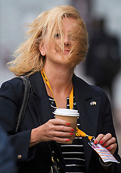 © Licensed to London News Pictures. 18/09/2018. Brighton, UK. Delegates brave windy conditions as they arrive for the final day of the 2018 Liberal Democrat Autumn Conference in Brighton. The recent warm spell is set to change for many over the next few days in the south. Photo credit: Ben Cawthra/LNP