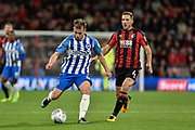 Brighton and Hove Albion midfielder Dessie Hutchinson (47) and AFC Bournemouth midfielder Dan Gosling (4) during the EFL Cup match between Bournemouth and Brighton and Hove Albion at the Vitality Stadium, Bournemouth, England on 19 September 2017. Photo by Adam Rivers.