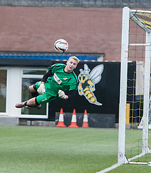 Alloa Athletic's keeper Scott Bain saves Falkirk's Phil Roberts shot.<br /> Alloa Athletic 0 v 0 Falkirk, Scottish Championship 12/10/2013. played at Recreation Park, Alloa.<br /> &copy;Michael Schofield.