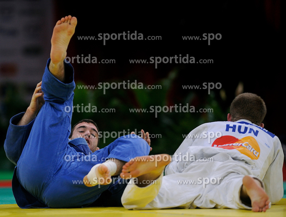 06-02-2011 JUDO: IJF GRAND SLAM PARIS 2011: PARIS.SEDEJ, Aljaz SLO and KRIZSAN, Szabolcs HUN.©2011-WWW.FOTOHOOGENDOORN.NL / SPORTIDA PHOTO AGENCY